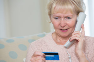 Credit Card Scam:Senior Woman Giving Credit Card Details On The Phone